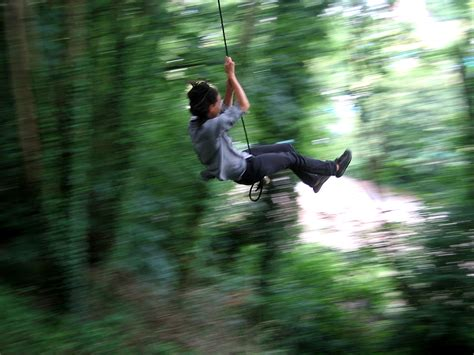 swinging on a rope rope swing bristol united kingdom uk