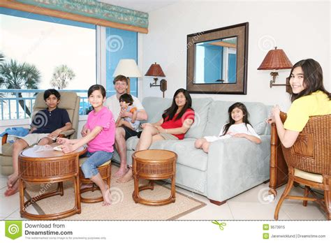 family in living room family relaxing in living room royalty free stock photo