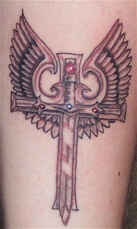 cross tattoo with jewels winged cross sword with gems tattoo tattooimages biz
