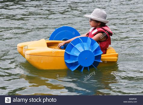 boat paddle pictures child rowing a paddle boat view from the side close up