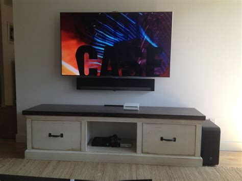 sound bar on top or below tv sonos sound bar mounted directly to the wall right below