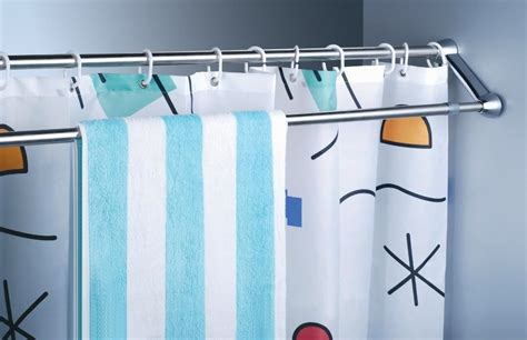 using shower curtains as drapes use extra shower curtain rods to increase bathroom storage