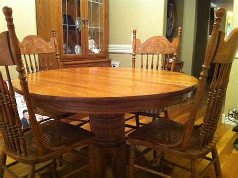 solid oak cottage style dining room table with 6 chairs