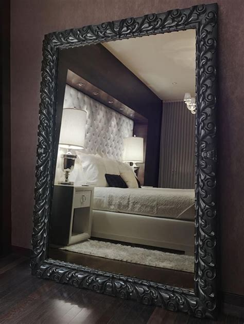 bedroom mirror oversized mahogany mirror on wood floor of bedroom