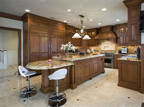 the cool kitchen island with granite top and seating
