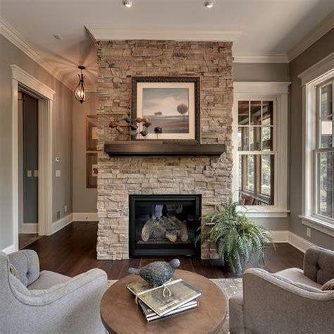 gray stacked stone fireplace  black hearth design