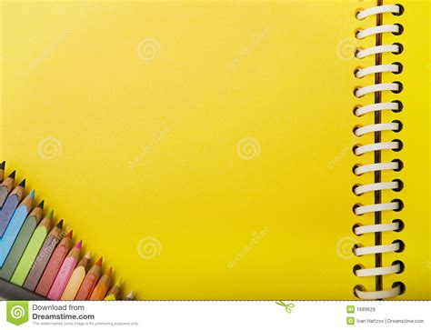 Yellow Spring Notebook And Crayons In A Corner Royalty