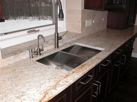 Stone Backsplash In Kitchen by Colonial Cream Granite