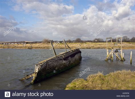 sunken river boats the wreck of a sunken wooden boat in the river medway