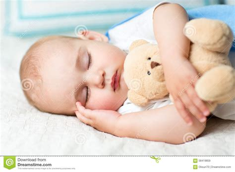sleeping with baby in bed baby sleeping on bed stock photo image 58419859