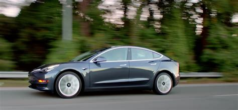 tesla model 3 gray motor trend pours on tesla model 3 gas 2