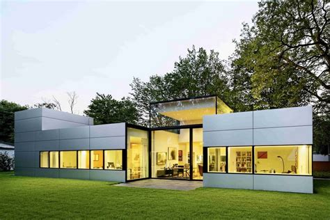 single story house modern single story cubical house with a metal facade in