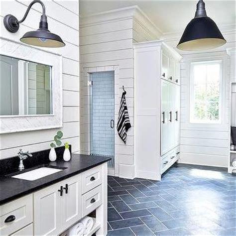white mudroom with charcoal gray slate herringbone tile