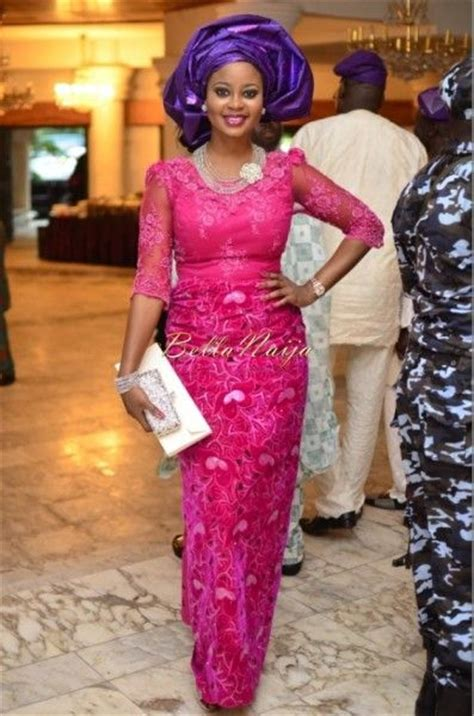 lace styles by bella nigerian wedding guest in pink iro and buba lace and
