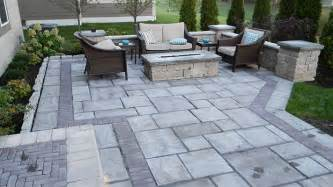 Paver Patio With Retaining Wall Landscaping Adds Privacy To Custom Paver Patio Landscaping Outdoor Kitchens Outdoor Living In
