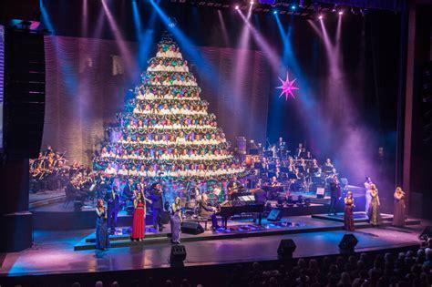 win tickets to the singing christmas tree raising edmonton