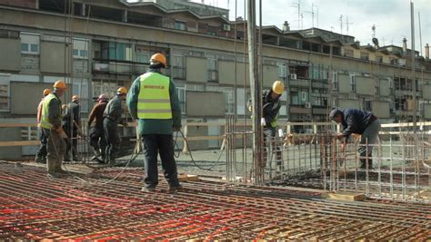 construction managers with protective helmets in project and discussing about the