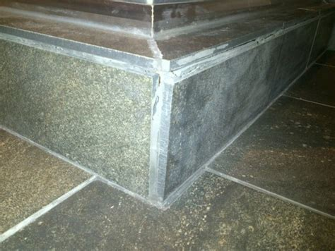 shower curb grout cracking