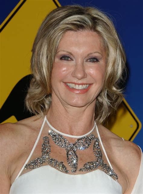 olivia newton john hairstyles olivia newton john with medium length flip hairstyle