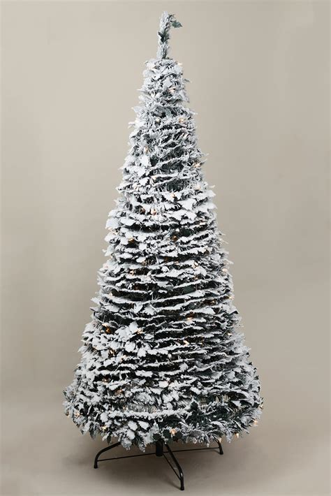 six foot accordion christmas tree snow covered with lights