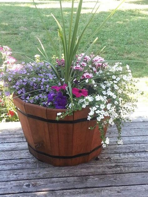 25 best ideas about whiskey barrel planter on