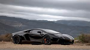 black lamborghini aventador on dirt road 1920x1080
