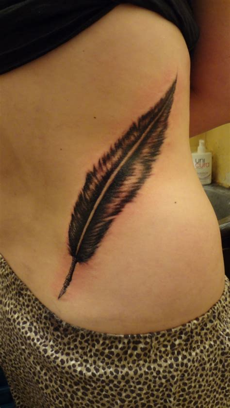 tattoo feather back feather tattoo on back