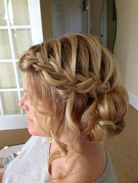 french braid low side messy french braid with loose pieces into low side chignon