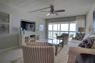 Using Room Dividers - vintage florida beach condo gets a transitional remodel beach style living room tampa by