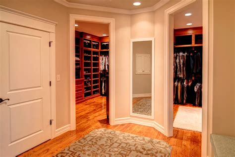 His Closet by Large Renovation By Farinelli Construction In
