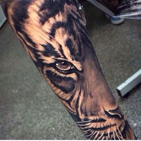 tiger forearm tattoo 61 all time best tiger tattoos designs with meanings