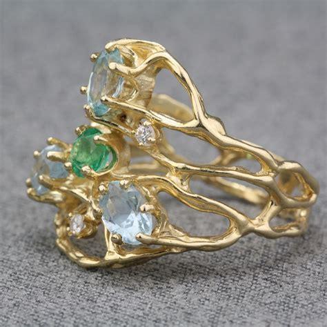 pre owned 14 karat yellow gold multi gemstone ring