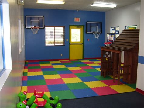 charming playroom decorating ideas with colorful mat and f basketball hoop attached on blue
