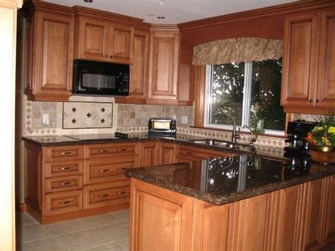 kitchen with cabinets restained kitchen cabinets these kitchen cabinets were