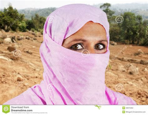 muslim pink middle aged muslim in pink stock photography image