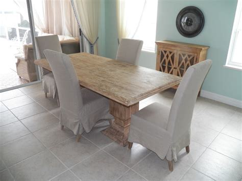 double pedestal dining table with slip cover dining chairs