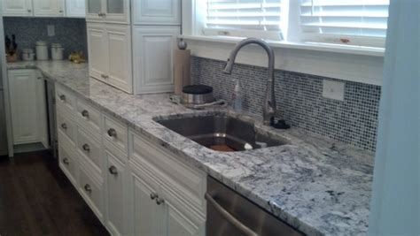 Granite Countertops By Granite Home Design Llc Michigan White Granite White Cabinets Backsplash Ideas