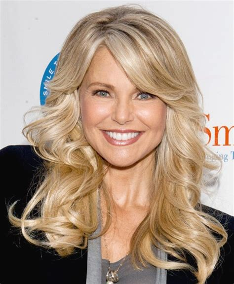 hair changes to wavy in middle age fall hairstyle idea flicked back long blonde waves