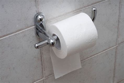 how to hang toilet paper you re hanging your toilet paper wrong reader s digest