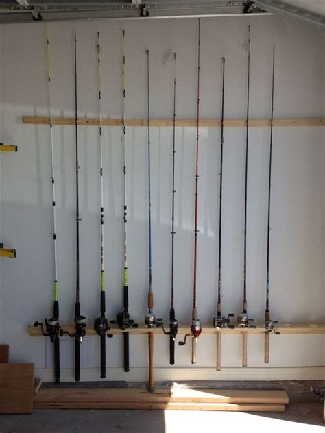 diy fishing rod holder diy fishing rod holder for the garage home fishing rods my boys and fishing