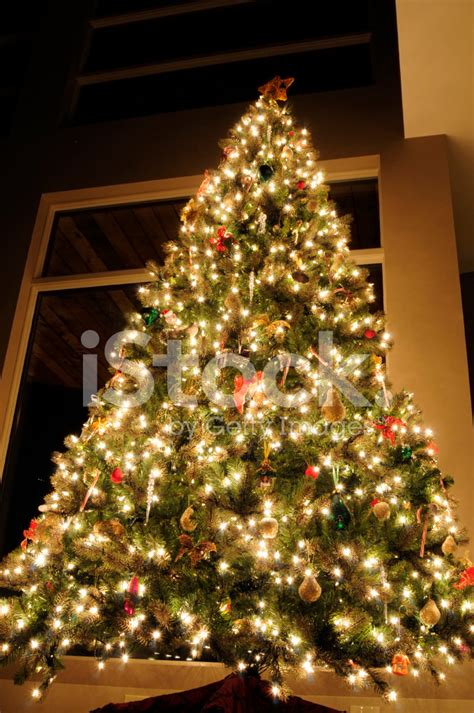 white bows for tree tree with white lights and stock photos