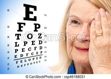 face shot of senior woman with vision test chart. close up