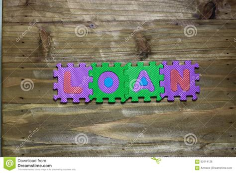 Loan Letters Crossword Puzzle Clue Block Letters And Word Loan With Wood Background Stock Photo Image 63114126