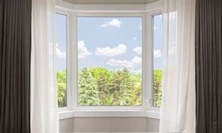 hanging curtains in a bay window the 4 best ways to hang bay window curtains overstock
