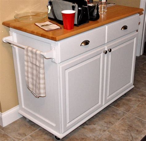 rolling islands for kitchen rolling kitchen island by inmysparetime lumberjocks woodworking community