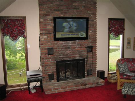 how to hang tv above brick fireplace and hide wires best