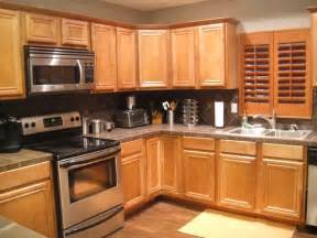 Kitchen With Light Oak Cabinets by Honey Oak Cabinets With Very Dark Grey Wall Light Grey