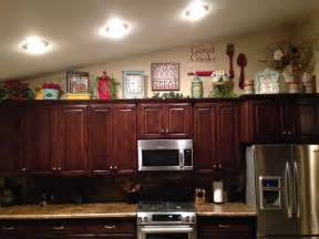 Decorating Ideas For Above Cabinets In Kitchen Above Kitchen Cabinet Decor Home Sweet Home