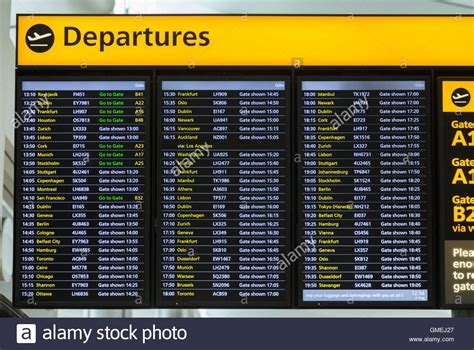 uk airport arrivals and departures information websites flight departures information notice board sign at