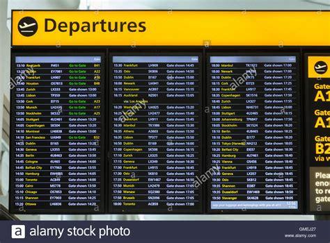flight arrivals and departures heathrow international airport london flight departures information notice board sign at